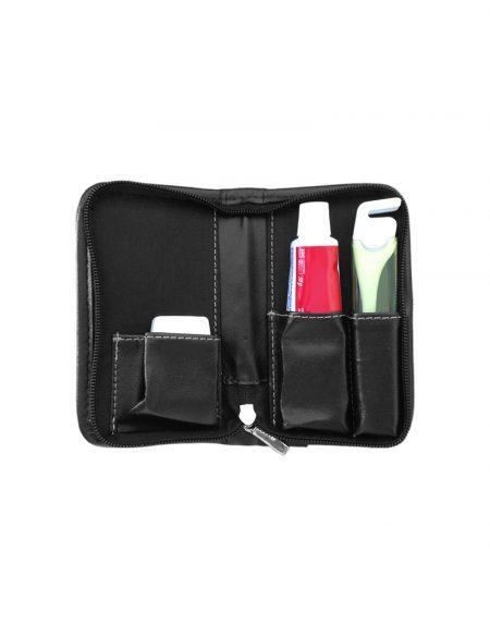Kit higiene bucal em sintetico preto com creme dental fio dental e escova de dentes foto dele aberto